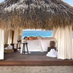 This is a view of a massage on the beach in front of Cabo Azul Resort.